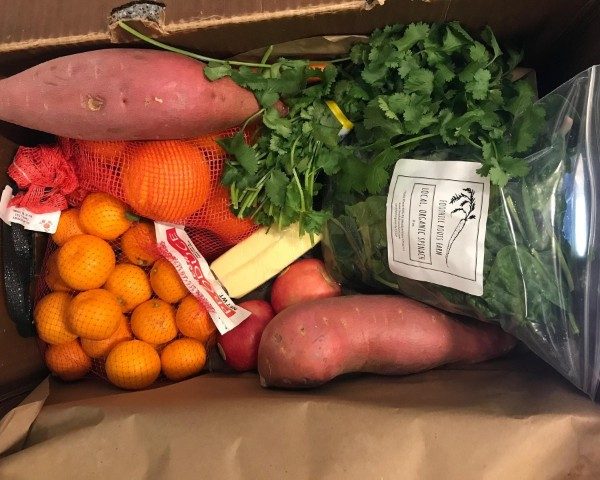 Box full of various fruits and vegetables