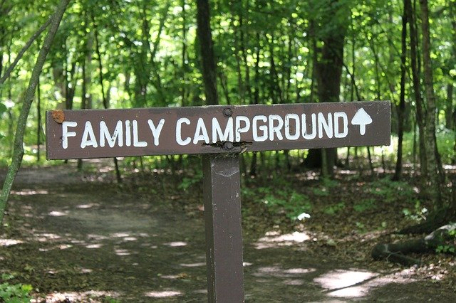 sign pointing to campground