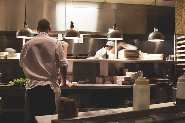 workers in restaurant kitchen
