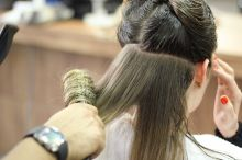 Woman's hair being styled at a salon